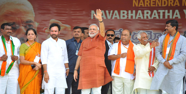 narendra_modi_waves_to_the_mega_crowd_at_hyderabad